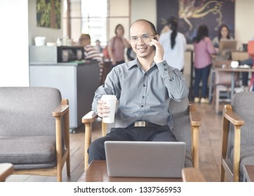 Using smartphone during coffee time, online business concept