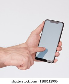 Using smartphone with notch isolated on white studio background