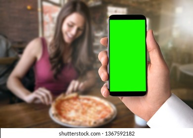 Using smartphone at pizza restaurant to order food, blank screen template