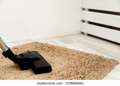 using vacuum cleaner while cleaning carpet in the house