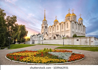 Uspenskiy cathedral on sunset with flowerbed on foreground in Vladimir, Russia