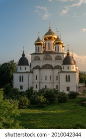 Uspensky Cathedral in Dmitrov near Moscow, Russia, in a park with green lawn and trees in a sunny summer day