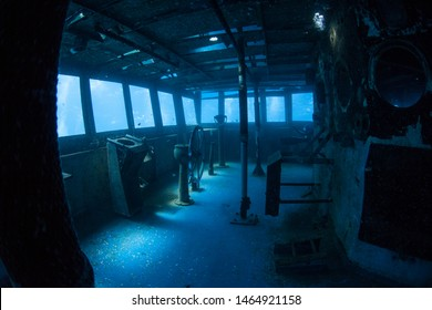 The USS Kittiwake, one of the best-known wreck dives in the Caribbean Sea, now lies empty. The 251-foot long ship was sunk off the coast of Grand Cayman in 2011 in order to create an artificial reef.