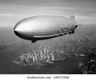 USS Macon, sister ship of USS Akron, over New York Harbor, ca. 1933. USS Macon, participated in Naval operations until crashing in a storm off Point Sur, California, on Feb. 12, 1935.