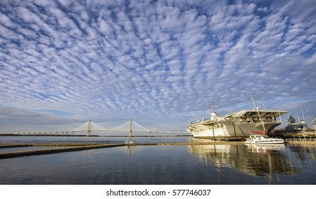The USS Yorktown aircraft carrier (now a museum) and Arthur Ravenel Bridge under a dramatic sky. Charleston, South Carolina.