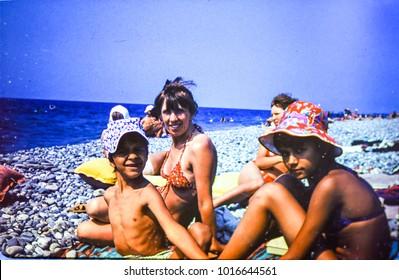 USSR, ABKHAZIA, LESELIDZE - CIRCA 1981: Vintage photo of family beach scene in Leselidze village, Abkhazia, USSR