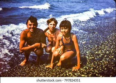 USSR, ABKHAZIA, LESELIDZE - CIRCA 1981: Vintage photo of family beach photo on Black sea in Leselidze, Abkhazia, USSR