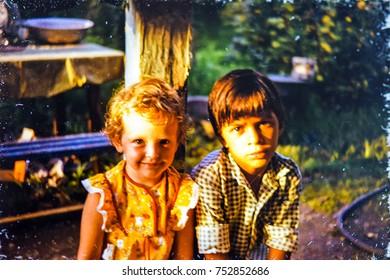 USSR, ABKHAZIA, LESELIDZE - CIRCA 1983: Vintage photo of little girl with little boy friend portrait in Leselidze, Abkhazia, USSR
