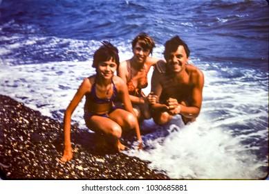 USSR, ABKHAZIA, LESELIDZE VILLAGE - CIRCA 1982: Vintage photo of happy family beach photo