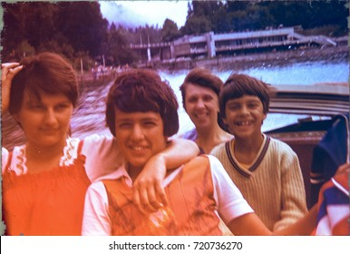 USSR, ABKHAZIA, MOUNTAIN RITSA LAKE - CIRCA 1982: Vintage photo of family trip on river boat on mountain Ritsa lake in Abkhazia, USSR