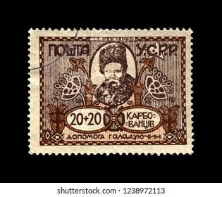 USSR - CIRCA 1923: stamp printed in Ukrainian Soviet Socialist Republic shows famous ukrainian poet Taras Shevchenko, famine help, circa 1923. vintage postal stamp isolated on black background.