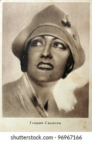 USSR - CIRCA 1928: Postcard printed in the USSR shows photo of Gloria Swanson American actress, singer and producer (1899-1983), circa 1928. Text in Russian: Gloria Swanson.