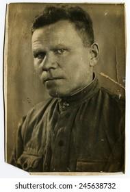 Ussr - CIRCA 1930s: An antique Black & White photo show brutal man