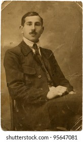 USSR - CIRCA 1930s: portrait of a man sitting on a chair in a jacket, USSR, 1930s