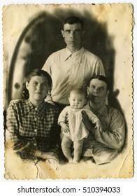 Ussr - CIRCA 1940s: An antique Black & White photo show studio family portrait