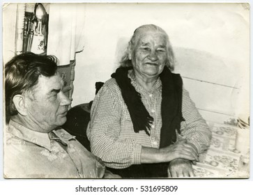 Ussr - CIRCA 1940s: An antique Black & White photo show  man and a middle-aged woman