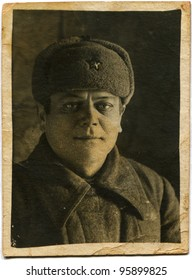 USSR - CIRCA 1942: Portrait of a soldier of the Soviet Army in winter clothes, circa 1942