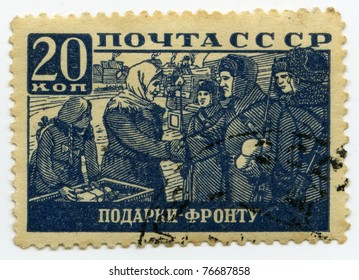 """USSR - CIRCA 1942: A postage stamp printed in USSR shows """"Help people to soldiers during the World War II"""" , circa 1942"""