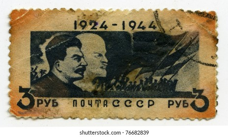 """USSR - CIRCA 1944: A postage stamp printed in USSR shows """"Lenin and Stalin"""" , circa 1944"""