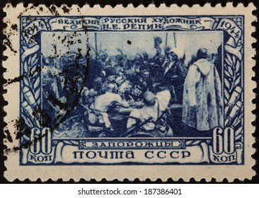 USSR - CIRCA 1944: A stamp printed in USSR shows group of people near table, circa 1944