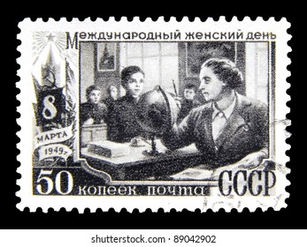 """USSR - CIRCA 1949: stamp printed in the USSR (Russia) shows a woman teacher with inscription """"International Women's Day March 8, 1949"""" from the series """"International Women's Day March 8"""", circa 1949"""