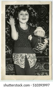 USSR - CIRCA 1950: An antique photo shows Girl with a toy gnome