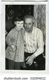 USSR - CIRCA 1950: An antique photo shows Grandfather and granddaughter