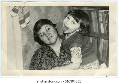 USSR - CIRCA 1950: An antique photo show mother with daughter