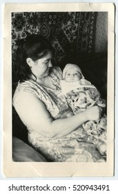 USSR - CIRCA 1950: An antique photo shows Mom and little baby