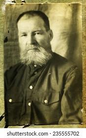 Ussr - CIRCA 1950s: An antique Black & White photo show serious man with a beard chic