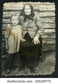 USSR - CIRCA 1950s: An antique photo show grandmother with two grandchildren