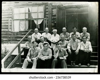USSR - CIRCA 1950s An antique photo shows a group of people on the porch of the hospital