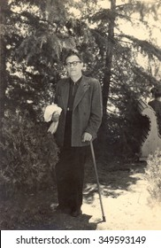 Ussr - CIRCA 1952s: An antique Black & White photo of Old man with walking stick.