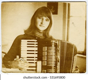Ussr - CIRCA 1960s: An antique Black & White photo show Girl with accordion