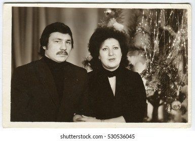 USSR - CIRCA 1960s: Christmas family portrait on the background of trees