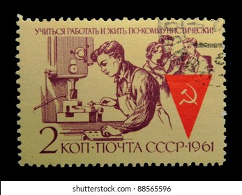 """USSR - CIRCA 1961: stamp printed in the USSR (Russia) shows Collective working with the inscription """"Learn, work and live in a communist"""" from the series """"The collective of communist labor"""",circa 1961"""