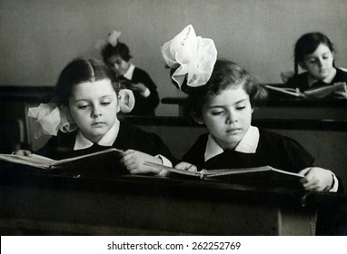 Ussr - CIRCA 1963s: An antique Black & White photo of Portrait of girls reading book in classroom