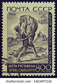 """USSR - CIRCA 1966: A stamp printed in USSR from the """"800th birth anniversary of Georgian poet Shota Rustaveli"""" issue shows The Knight in the Tiger's Skin, circa 1966."""