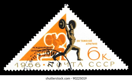 """USSR - CIRCA 1966: stamp printed in the USSR (Russia) shows a weightlifter with the inscription and name of a series """"1966, International competitions in weightlifting"""", circa 1966."""
