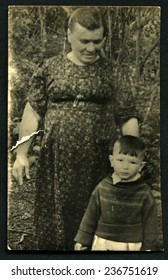 Ussr - CIRCA 1970s: An antique Black & White photo show mother with son