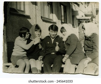 Ussr - CIRCA 1970s: An antique Black & White photo show group of young people on a bench