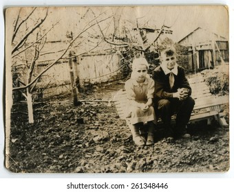 Ussr - CIRCA 1970s: An antique Black & White photo show a boy and a girl sitting on a bench
