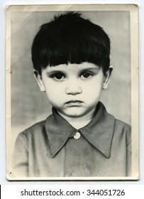 Ussr - CIRCA 1970s: An antique Black & White photo show little boy
