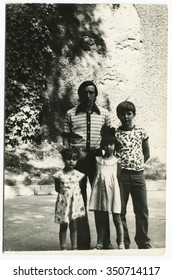 Ussr - CIRCA 1970s: An antique Black & White photo show father of three children