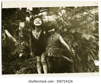 Ussr - CIRCA 1970s: An antique Black & White photo show two little beautiful girls in the garden