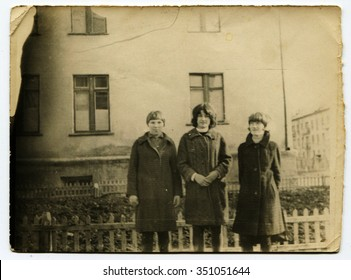 USSR - CIRCA 1970s: An antique Black & White photo shows three girls on the background of the house