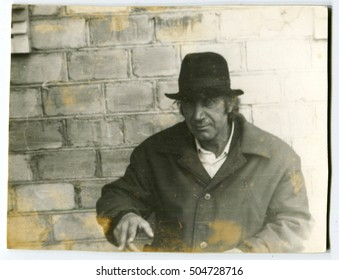 Ussr - CIRCA 1970s: An antique Black & White photo show  portrait of a man in a hat