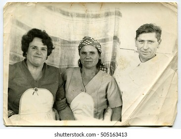 Ussr - CIRCA 1970s: An antique Black & White photo show man and two women
