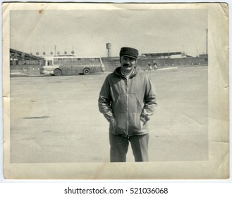 Ussr - CIRCA 1970s: An antique Black & White photo shows man with a mustache is near the train station