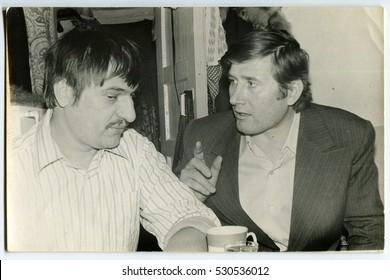 Ussr - CIRCA 1970s: An antique Black & White photo show Two men drink tea